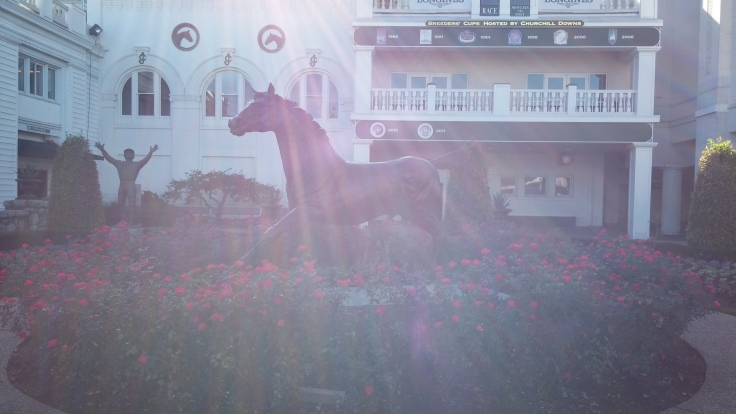 A sun-bathed moment with Aristides: first winner of the Kentucky Derby, and perpetual guardian of the Churchill paddock.