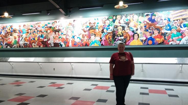 The jockey mural is very bright.