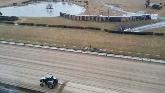 Come rain, come slush, it is still a good day for the races.
