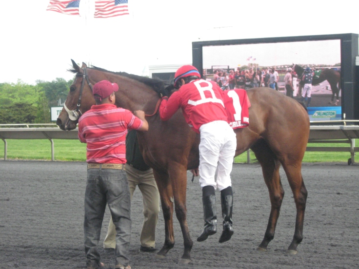 Jose Valdivia, Jr. hops off of Canadian Candy, a three-year-old half-sister to Illinois-bred stakes winner Pistols Drawn.  Canadian Candy got embroiled in a speed duel with Smart Kiara in the seventh race, and finished fifth.