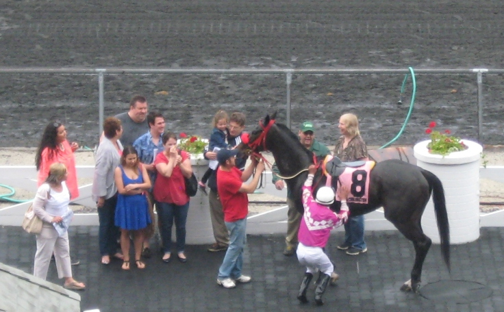 Even the people in the winners' circle look a bit surprised after Josh, the longest shot on the board, won Sunday's 6th.