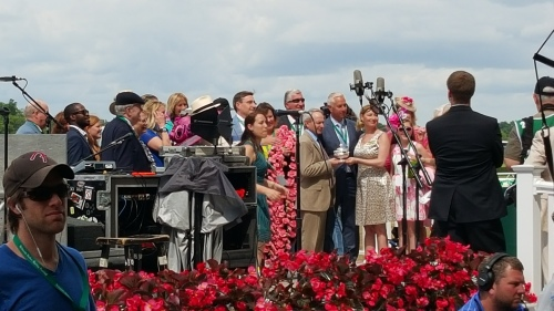 Todd Pletcher and Eclipse Thoroughbred Partners accept Curalina's Acorn trophy.