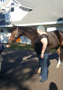 Giving Rachel Alexandra a pat on the shoulder. (Photo: Melissa Bauer-Herzog.)