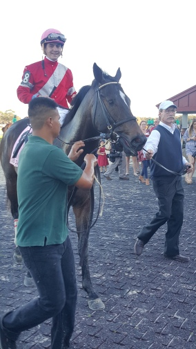 McCraken and one very happy Brian Hernandez after their victory in the Sam F. Davis (G3).